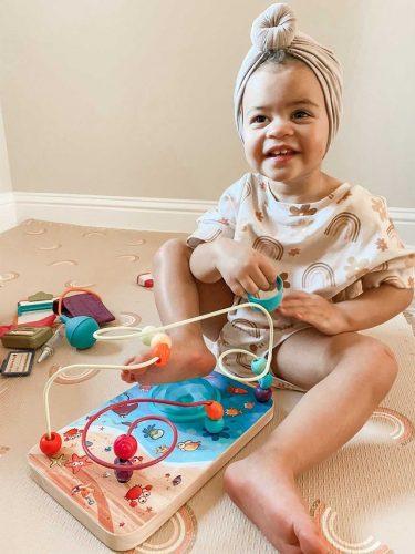 Child with wire maze.