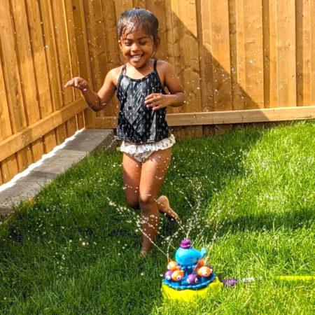 Girl with sprinkler.