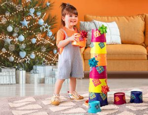Girl with stacking cups.