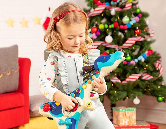 Girl playing toy guitar.