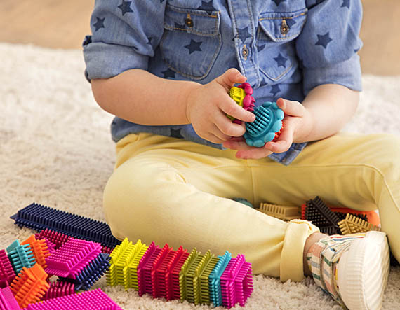 Child playing with building blocks.