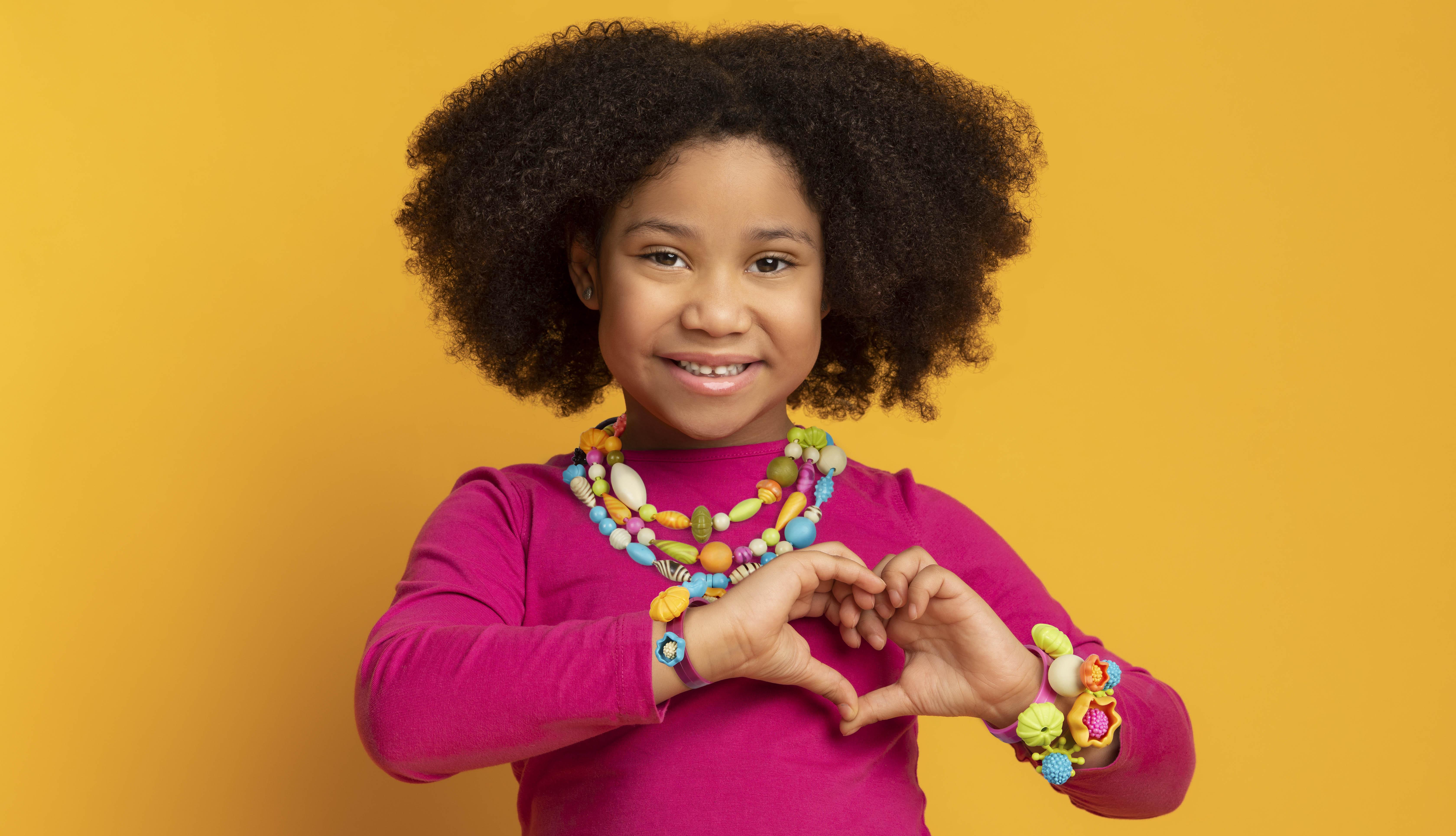 Girl wearing DIY jewelry.