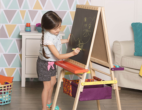 Girl drawing on blackboard.