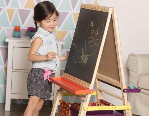 Girl drawing on easel.