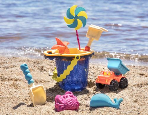 Beach toy set with a bucket, rake, shovel, sand molds, etc.