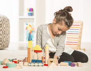 Girl with architectural blocks.
