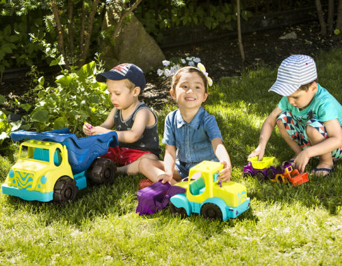 Three toddlers with toy construction vehicles.