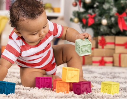 Baby playing with colorful blocks.