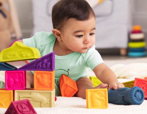 Baby playing with blocks.