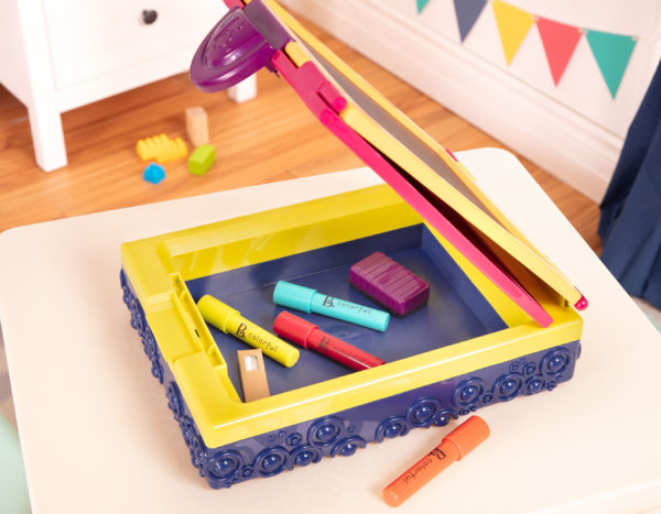 Colored markers inside a tabletop easel.