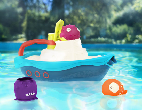 Bath toy set with a boat and 3 accessories, floating in a pool.
