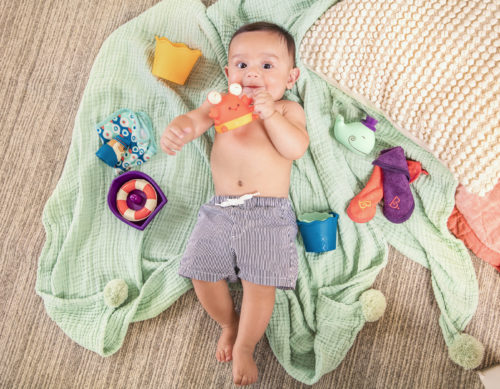 Baby with bath toy set.