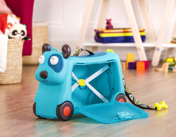 Dog-shaped suitcase for kids, opened on the floor.