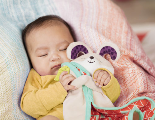 Sleeping baby with security blanket.