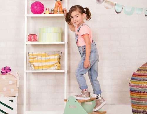 Girl on step stool.