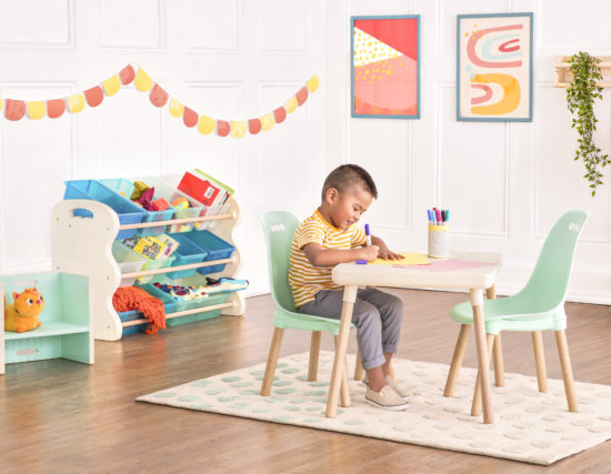 Boy drawing at a kids table.