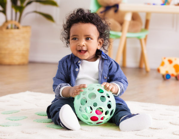 Smiling baby with ball.