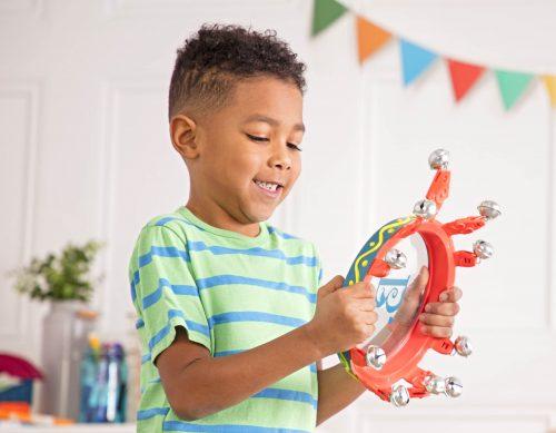 Boy playing on tambourine.