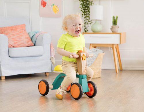 Boy riding wooden bike.
