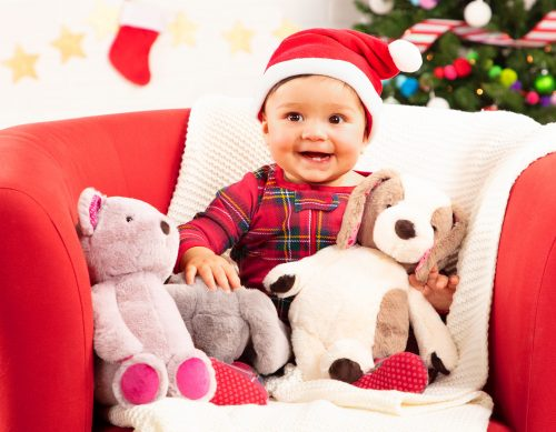 Baby with stuffed animals.