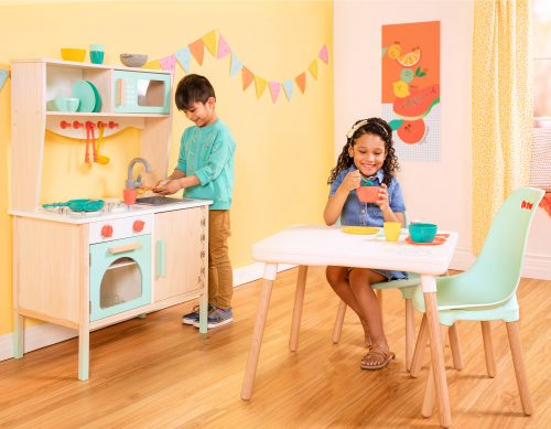 Boy and girl in play kitchen.