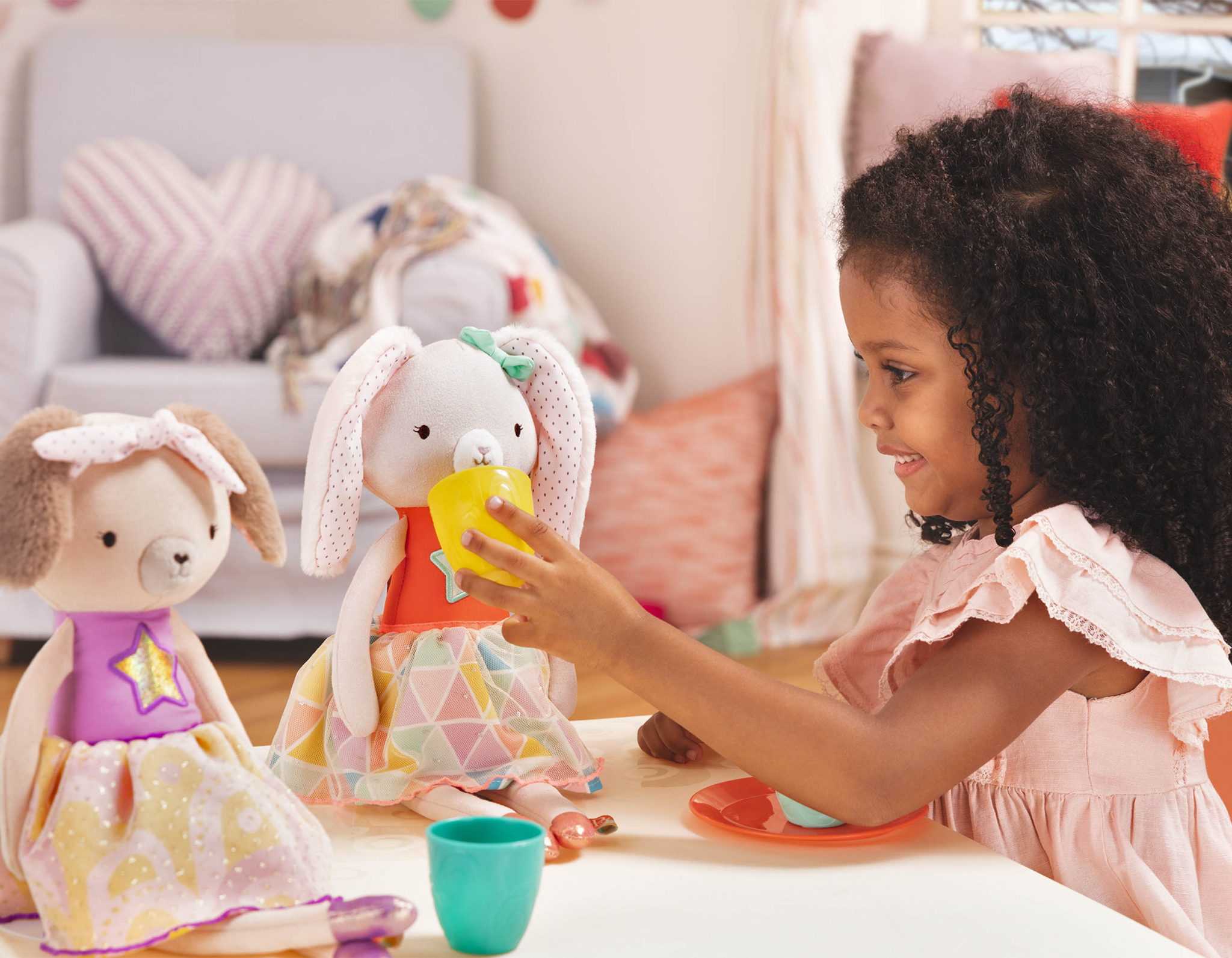 Girl and two stuffed animal dolls.