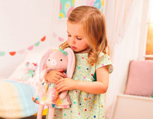 Girl with plush bunny doll.