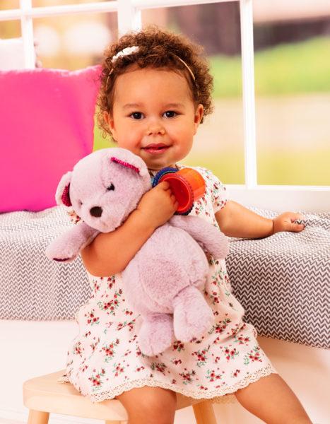 Toddler hugging a teddy bear.