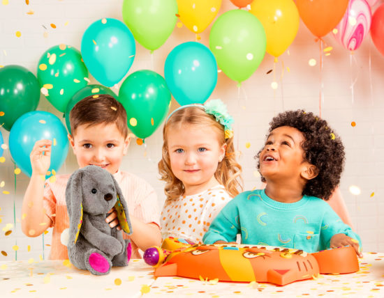 Kids with balloons and toys.