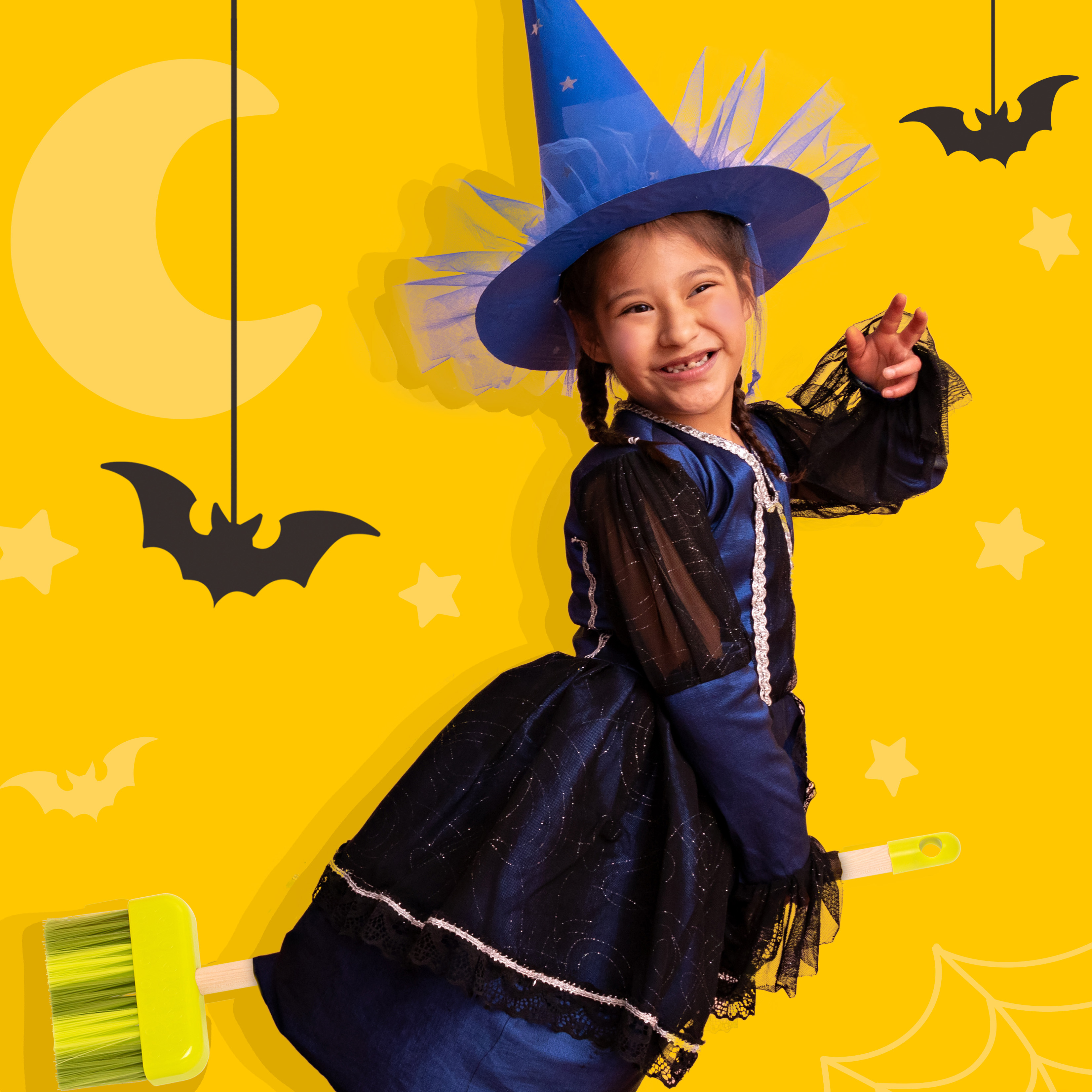 Girl in witch costume.