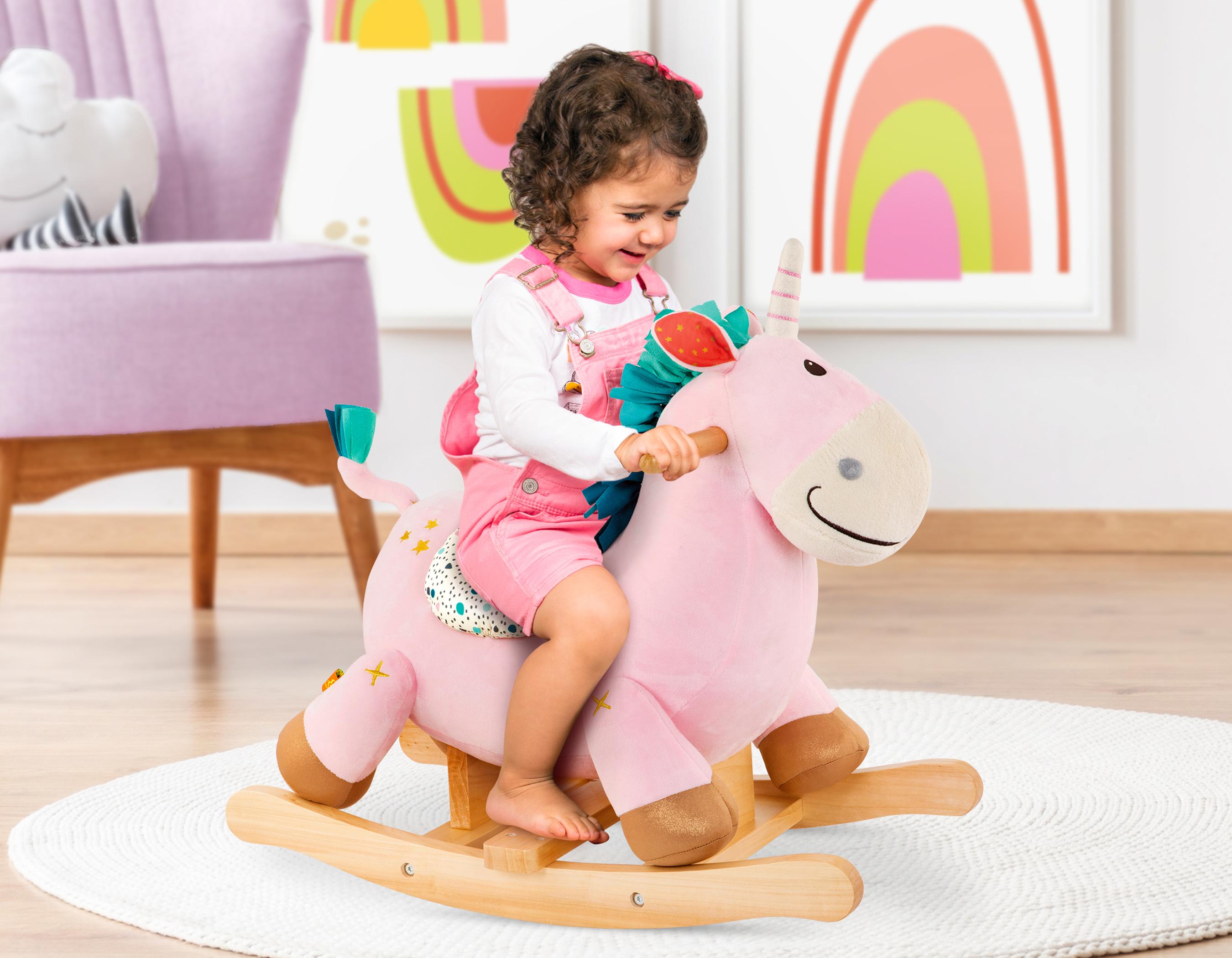 Girl on rocking unicorn.