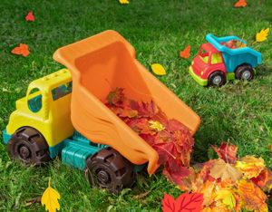 Two toy dump trucks.