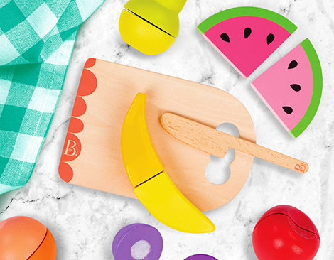 Wooden cutting board and play food.