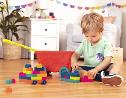 Boy playing with colorful building blocks.