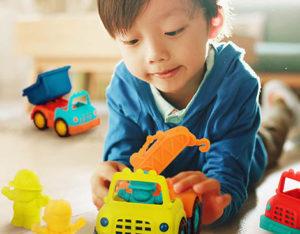 Boy with toy trucks.