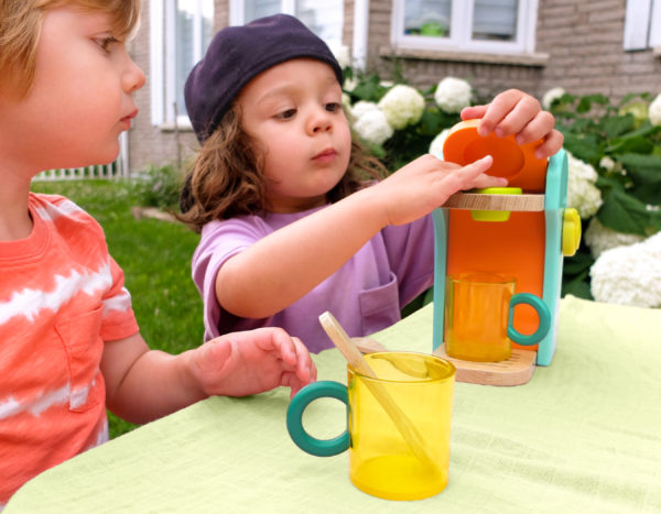 Kids playing with coffee maker set.