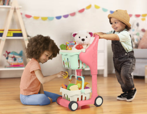 Boy and girl playing with toy shopping cart.