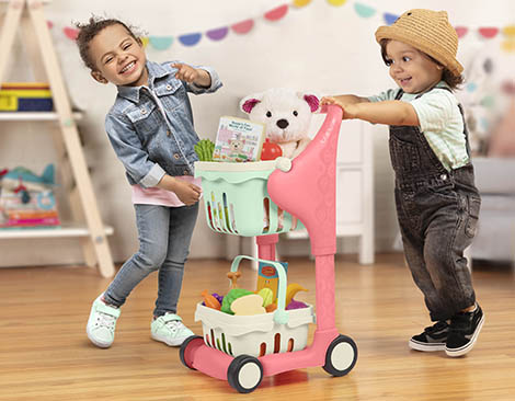 Girl and boy with toy shopping cart.