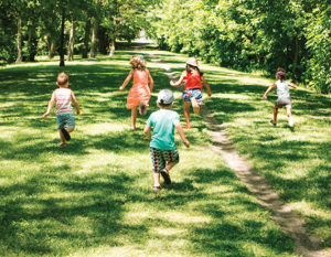 Kids running in a park.