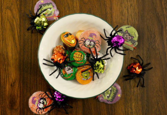 Bowl with toys, candy and toy spiders.