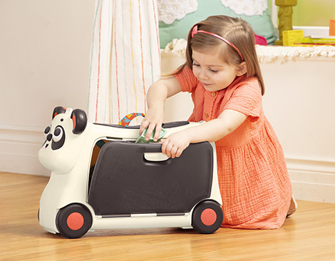 Girl with ride-on suitcase.