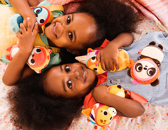 Two girls with small stuffed animals.
