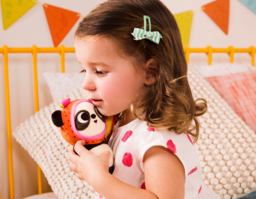 Girl with small plush panda toy.