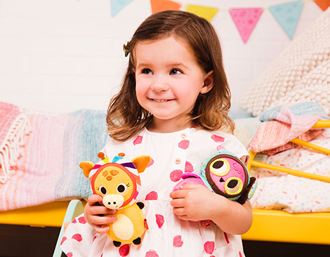 Girl with two small plush toys.
