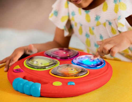 Girl pushing button on musical toy.