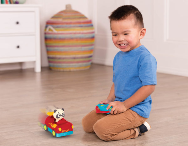 Boy with remote control race car.